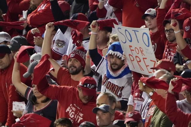 Fans cheer before Game 3 of the baseball World Series between the Houston Astros and the Washington Nationals Friday, Oct. 25, 2019, in Washington. (AP Photo/Alex Brandon)