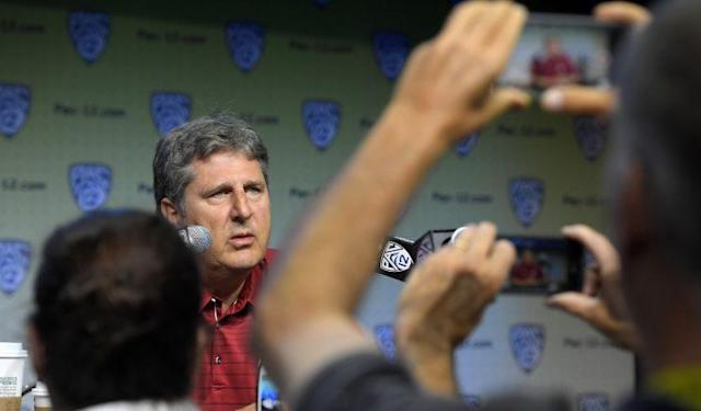 Washington State's Mike Leach wax poetic about a number of subjects on Thursday. (AP Photo/Mark J. Terrill)