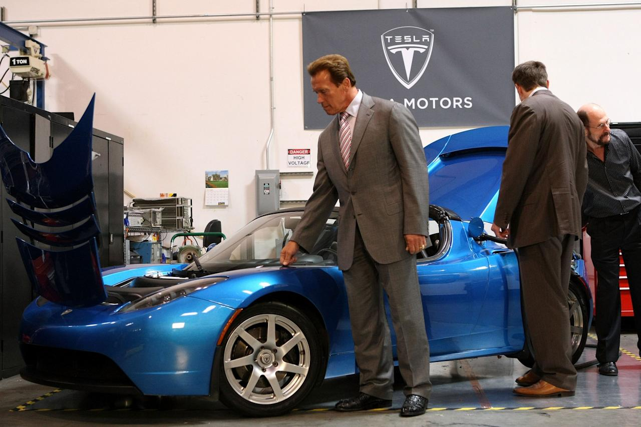 <p>Then governor of California, Arnold Schwarzenegger, was given a personal tour of the Tesla base in San Carlos adding a bit of Hollywood glamour and political weight to the fledgling company. Tesla announced plans for an all-new production facility in the state. (Justin Sullivan/Getty Images) </p>