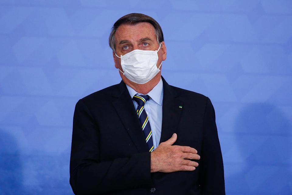Brazilian President Jair Bolsonaro gestures during the 'Socio-environmental Actions and Adherence to the Adopt a Park Programme' event at Planalto Palace in Brasilia, on May 12, 2021. (Photo by Sergio Lima / AFP) (Photo by SERGIO LIMA/AFP via Getty Images)
