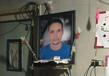 A photograph of Lotfy Ibrahim is seen on a wall at his family home in Kafr al-Sheikh