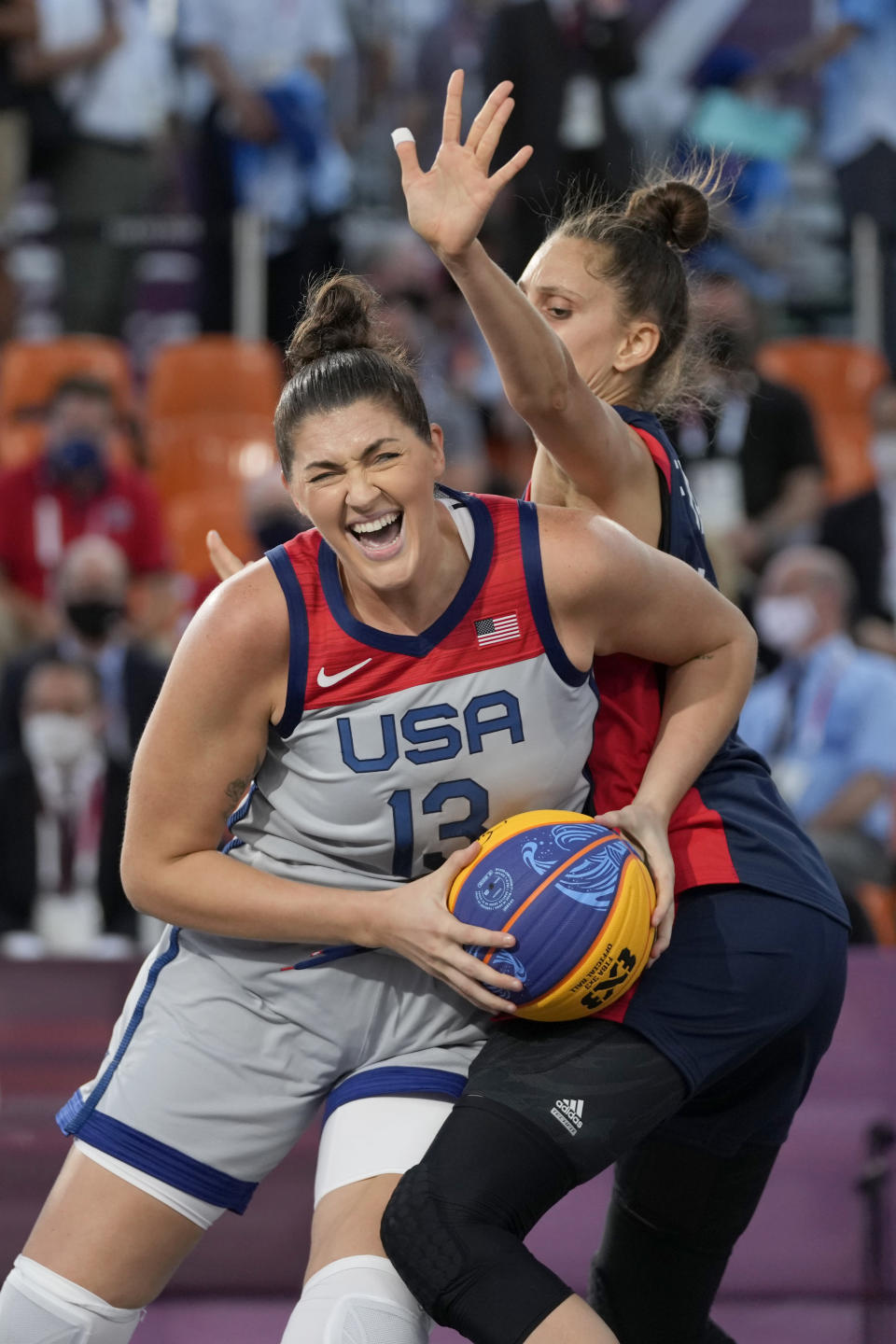 United States' Stefanie Dolson (13) heads to the basket past as France's Ana Maria Filip defends during a women's 3-on-3 basketball game at the 2020 Summer Olympics, Saturday, July 24, 2021, in Tokyo, Japan. (AP Photo/Jeff Roberson)