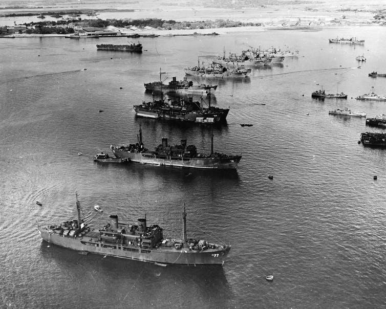 Black and white image showing anchored ships.