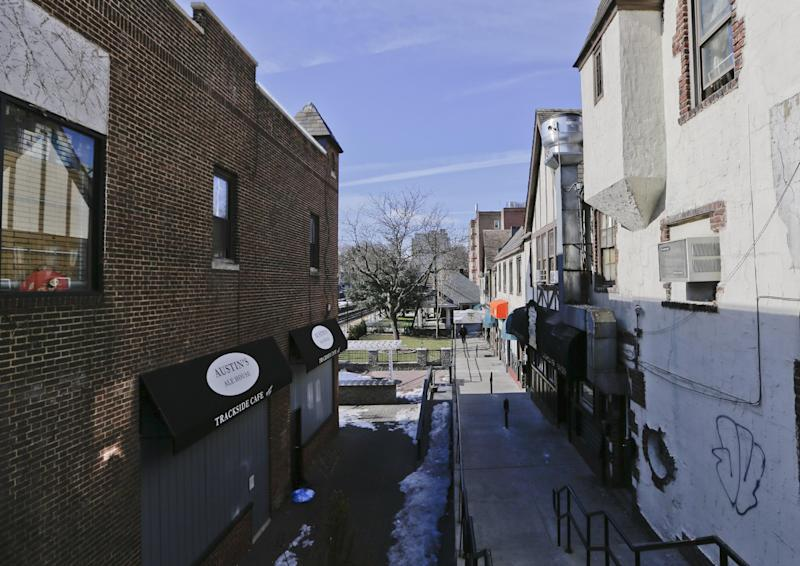 In this March 6, 2014 photo, a walkway leading past the entrance of 82-70 Austin Street is shown in the Queens borough of New York. The 50th anniversary of the killing of Kitty Genovese's, whose screams could not save her the night she was stalked and killed in the neighborhood on March 13, 1964, is on Thursday. (AP Photo/Frank Franklin II)