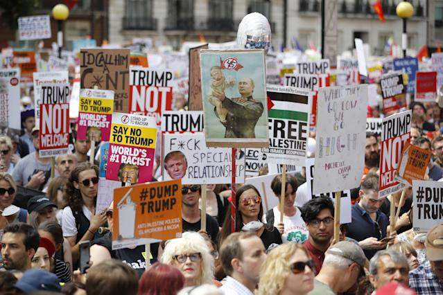 Protesters take part in a march and rally in central London on Friday. (Photo: Tolga Akmen/ FP/Getty Images)