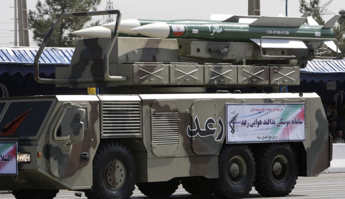 A Raad air defense system with Taer missiles is displayed by Iran's Revolutionary Guard, during a military parade commemorating the start of the Iraq-Iran war 32 years ago, in front of the mausoleum of the late revolutionary leader Ayatollah Khomeini, just outside Tehran, Iran, Friday, Sept. 21, 2012. Iran has displayed a new, all-Iranian-made air defense system that is reportedly an upgrade of an earlier Russian-made mobile model. The semi-official Fars news agency says the Raad, or Thunder, is more advanced than its Russian predecessor and is designed to confront fighter jets, cruise missiles, smart bombs, helicopters and drones. The agency says Raad carries missiles with a range of 50 kilometers (30 miles), capable of hitting targets at 22,000 meters (75,000 feet). (AP Photo/Vahid Salemi)