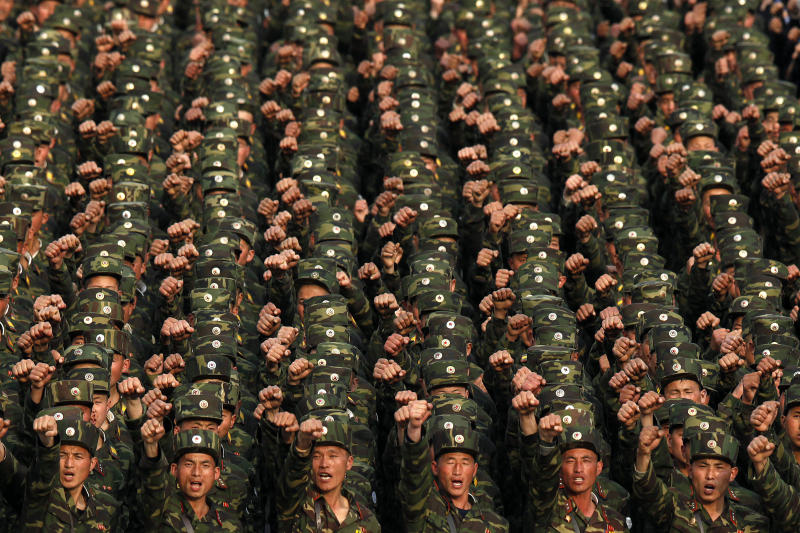 """FILE - In this April 20, 2012 file photo, North Korean soldiers chant at Kim Il Sung Square in central Pyongyang, North Korea, during a rally denouncing South Korean President Lee Myung-bak. North Korea's military vowed Monday, April 23, to launch unspecified """"special actions"""" soon meant to reduce South Korea's conservative government and media companies """"to ashes"""" in less that four minutes, in an escalation of its recent threats.  (AP Photo/Ng Han Guan, File)"""
