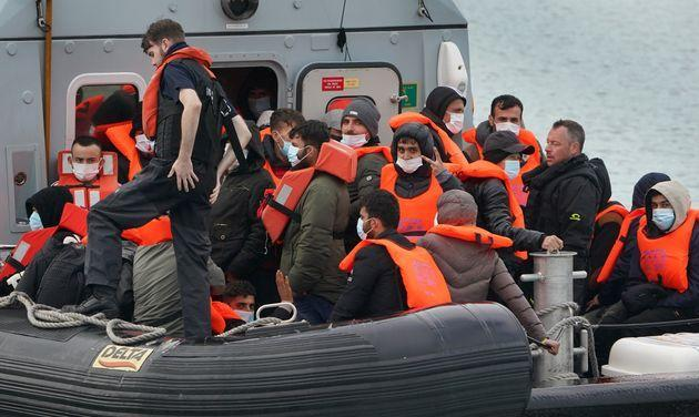 A group of people thought to be migrants are brought in to Dover, Kent, onboard a Border Force vessel following a small boat incident in the Channel (Photo: Gareth Fuller - PA Images via Getty Images)