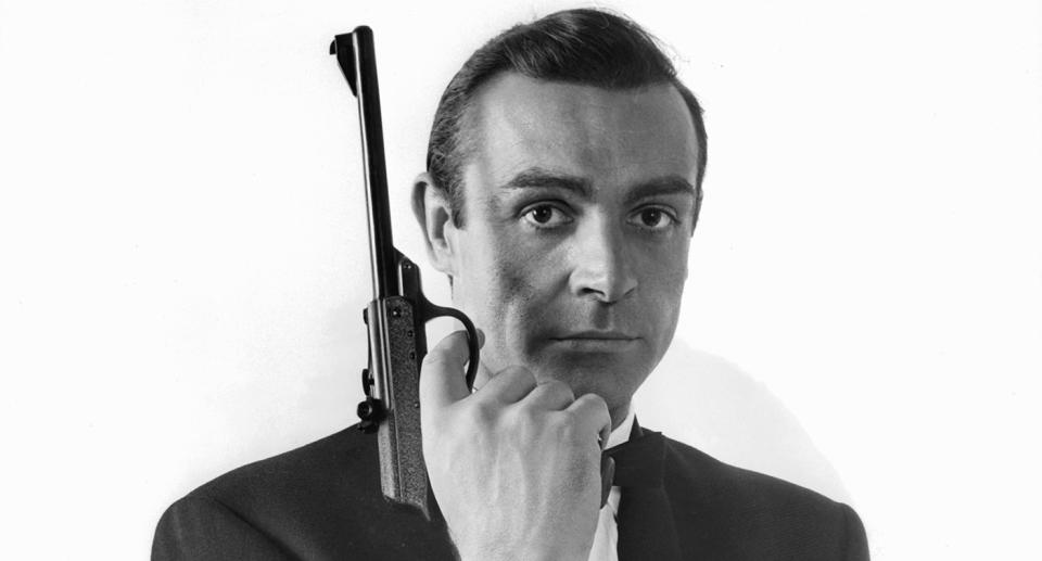 """James Bond icon Sean Connery died at the age of 90 in October due to <a href=""""https://uk.movies.yahoo.com/sean-connerys-cause-death-revealed-173036837.html"""" data-ylk=""""slk:pneumonia-related respiratory failure and atrial fibrillation;outcm:mb_qualified_link;_E:mb_qualified_link;ct:story;"""" class=""""link rapid-noclick-resp yahoo-link"""">pneumonia-related respiratory failure and atrial fibrillation</a>. He was the first actor to bring the spy to screen, appearing in seven of the films. Successful outside of the 007 films, he won the Academy Award for Best Supporting Actor at the 1988 ceremony for his role in <em>The Untouchables</em>. (Photo by United Artist/Getty Images)"""