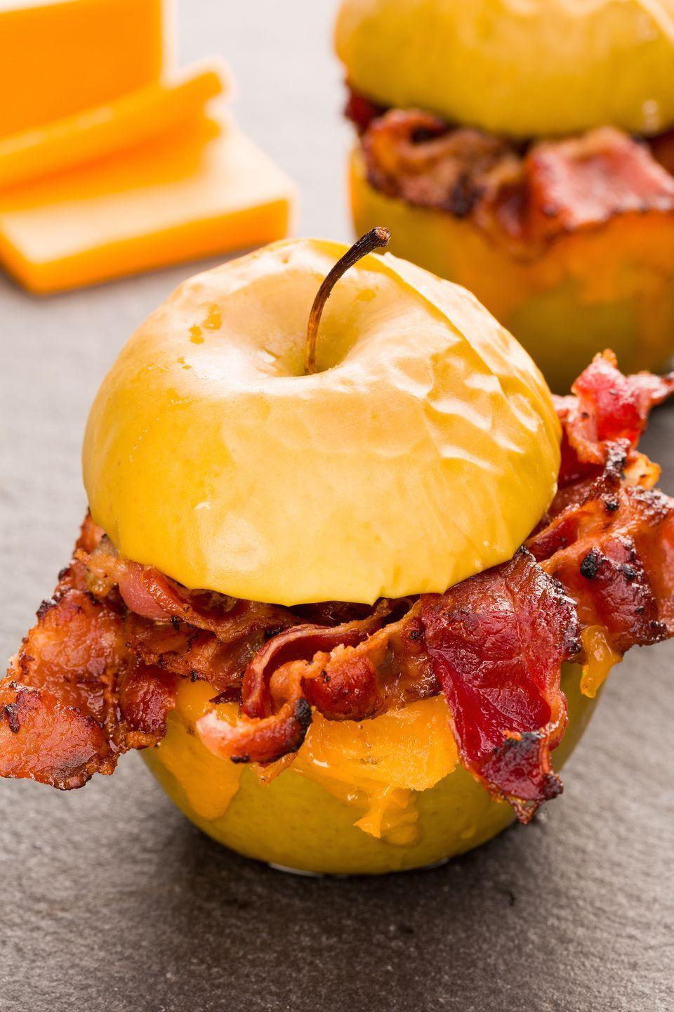 "<p>Bacon lovers, start your skillets: These halved baked apples are layered with crispy bacon and melted cheddar.</p><p>Get the recipe from <a href=""https://www.delish.com/cooking/recipe-ideas/recipes/a43873/baked-apples-with-bacon-and-cheddar-recipe/"" rel=""nofollow noopener"" target=""_blank"" data-ylk=""slk:Delish"" class=""link rapid-noclick-resp"">Delish</a>.</p>"