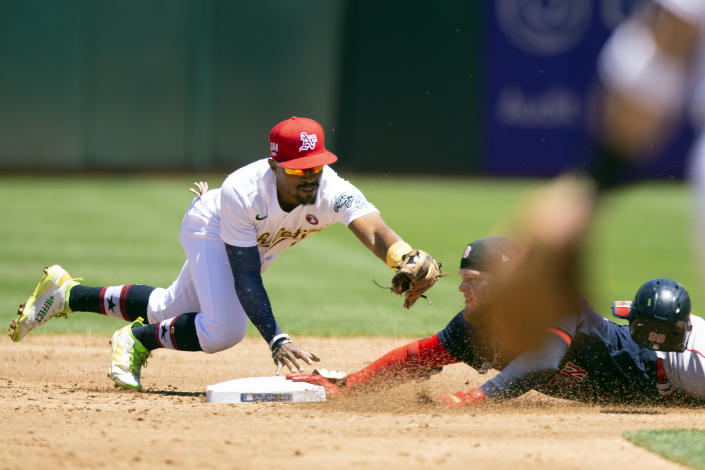 Boston Red Sox's Alex Verdugo, right, slides safely into second with a double ahead of a tag by Oakland Athletics second baseman Tony Kemp, left, during the third inning of a baseball game, Sunday, July 4, 2021, in Oakland, Calif. (AP Photo/D. Ross Cameron)