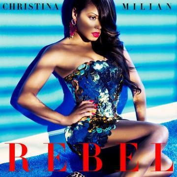 """It's here! It's here! <strong> Christina Milian</strong> is showing off her rebellious side in the sultry (and highly-anticipated) music video for her hot new single, """"Rebel,"""" and ETonline has the video exclusively in the player below. The video features Christina engulfed in an over-sized, dreamy parachute in several scenes and it perfectly encompasses the steamy sound and lyrics of the tune, which the 33-year-old singer confirms is inspired by her relationship with Lil Wayne. """"It's safe to say it is about the man in my life, yes,"""" Christina tells ETonline. """"There's nothing better than that feeling of new chemistry when you're so into someone and you could care less about what anyone else thinks… and there's butterflies! It's a real feeling that people experience."""" How cute! So, what does it mean to be a """"rebel"""" for someone? <strong>VIDEO:</strong> Christina Milian Accidentally Admits She """"Loves"""" Lil Wayne! """"For me, I'm so inspired by the relationship that I'm in that it's definitely an experience. It's that careless, hopeless, romantic love – that feeling of 'I will do anything for you' and it's just incredible and so yea, 'rebel for you' means 'I'm all about you.' We love that! Last month, Christina accidentally let it slip that she """"loved"""" the 32-year-old rapper during a radio interview(link), but she couldn't stop gushing about her man to ETonline, proudly admitting how much the Cash Money Entertainment CEO means to her. """"He's very special to me, yeah,"""" she answered when asked if the couple is in love. Splash News As for whether or not she sees wedding bells in their future, well, she was a little more coy about that. """"You never know, I mean, love does inspire beautiful things like that,"""" she shared. """"I don't put too much pressure on one thing but I'm just living freely with him and we're both very happy. I feel like if you don't put too much expectations and too much high-hopes into things then everything will fall into place."""" <strong>RELATED:</strong> Is Lil"""