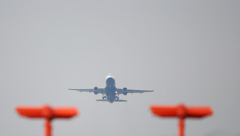 FILE PHOTO: A British Airways aircraft takes off from Heathrow Airport in west London