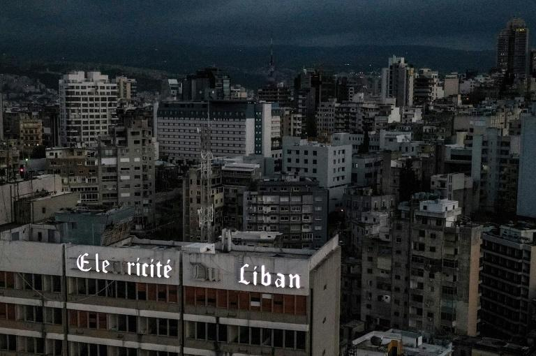 Darkness shrouds the Lebanese capital Beirut around the headquarters of the state electrity utility during one of the ever lengthening daily power blackouts