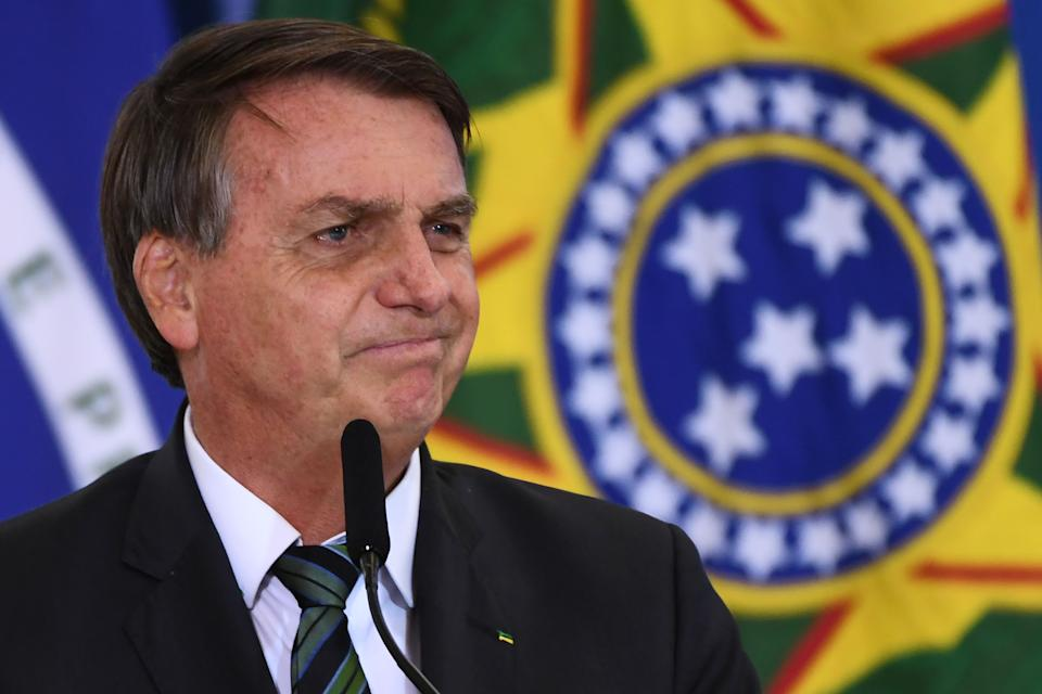 Brazilian President Jair Bolsonaro gestures during the Launch of the