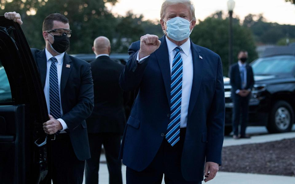 US President Donald Trump pumps his fist as he leaves Walter Reed Medical Center in Bethesda, Maryland - Saul Loeb/AFP