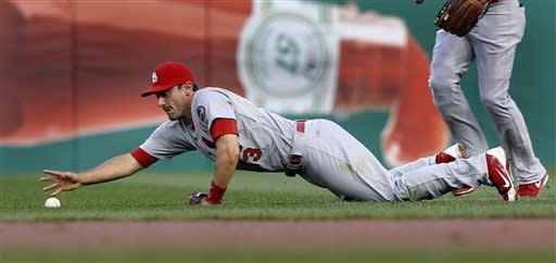 St. Louis Cardinals second baseman Matt Carpenter stretches to get the ball hit by Pittsburgh Pirates' Travis Snider for a single that drove in Starling Marte in the first inning of a baseball game, Wednesday, April 17, 2013, in Pittsburgh. (AP Photo/Keith Srakocic)