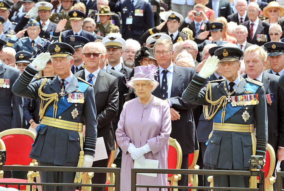 Queen Elizabeth II, the Duke of Edinburgh and Prince of Wales attend the unveiling of the Bomber Command Memorial in Green Park, London. PRESS ASSOCIATION Photo. Picture date: Thursday June 28, 2012. The memorial remembers the sacrifice and bravery of the 55,573 RAF crew who lost their lives in the Second World War. See PA story MEMORIAL Veterans. Photo credit should read: John Stillwell/PA Wire