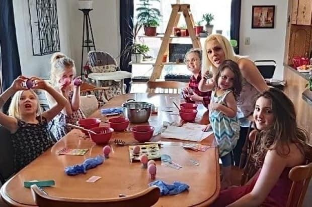Sheena Hearn, with five of her children, painting eggs for Easter.