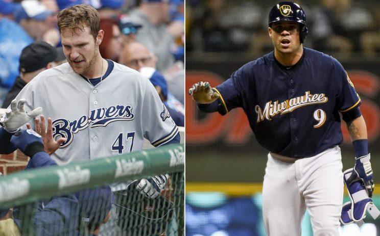 Catchers Jett Bandy (left) and Manny Pina (right) have played key roles in the Brewers respectable start. (AP photos)