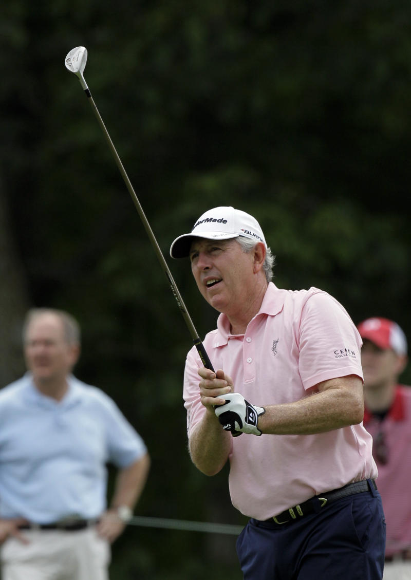 Hale Irwin watches his fairway shot on the 10th hole during the third round of the Senior PGA Championship golf tournament at Valhalla Golf Club, Saturday, May 28, 2011, in Louisville, Ky. (AP Photo/Ed Reinke)