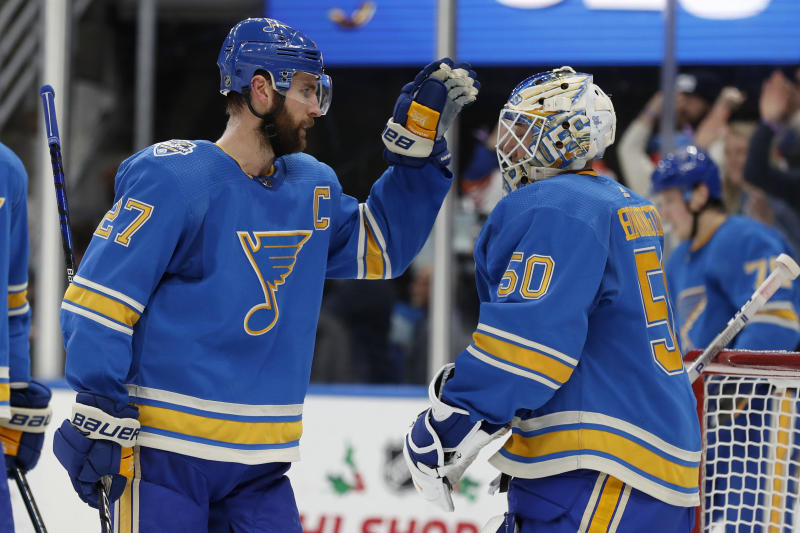 St. Louis Blues' Alex Pietrangelo, left, and goaltender Jordan Binnington celebrate a 4-3 victory over the Chicago Blackhawks in an NHL hockey game Saturday, Dec. 14, 2019, in St. Louis. (AP Photo/Jeff Roberson)
