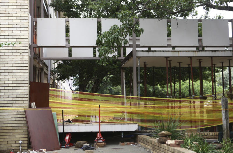Police tape cordons off the site of a walkway collapse at the Driehoek High School in Vanderbijlpark, South Africa, Friday, Feb. 1, 2019. At least 3 students were killed and scores injured at the school near Johannesburg, a South African official said. (AP Photo)