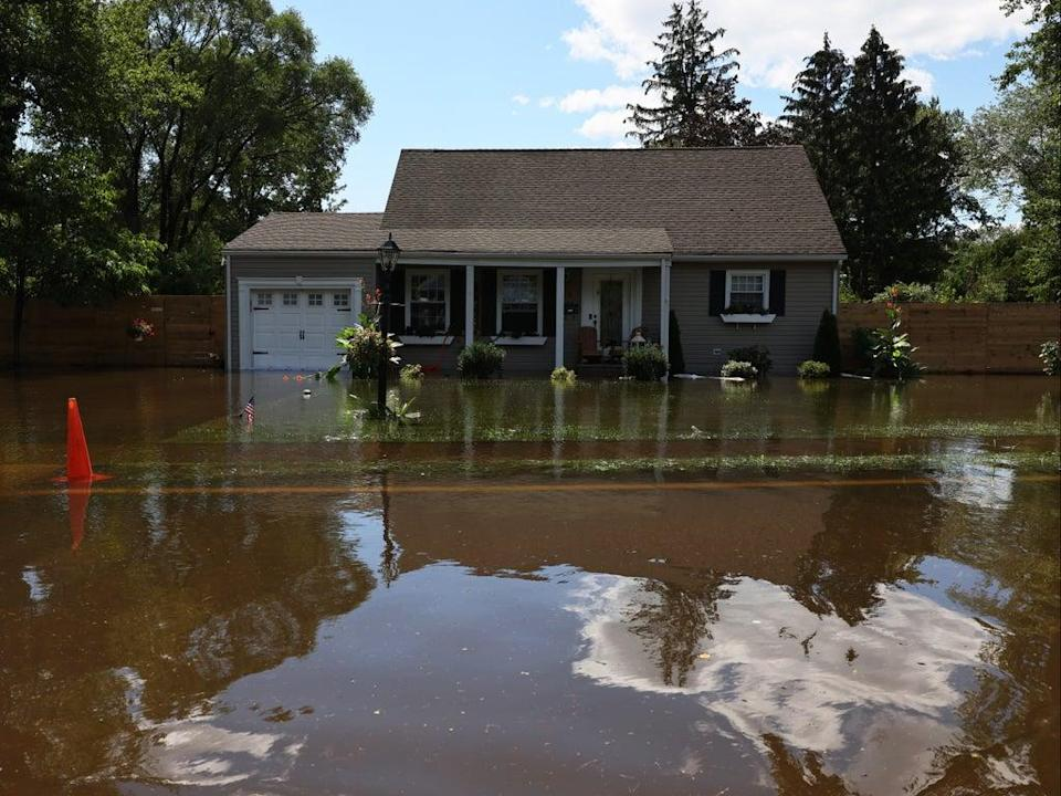 River water floods the front of a home on West Williams Street Road on September 02, 2021 in Lincoln Park, New Jersey (Getty Images)