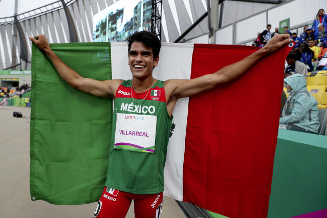 Jose Villarreal of Mexico celebrates winning the gold medal in the men's 1500m final during the athletics at the Pan American Games in Lima, Peru, Thursday, Aug. 8, 2019. (AP Photo/Martin Mejia)