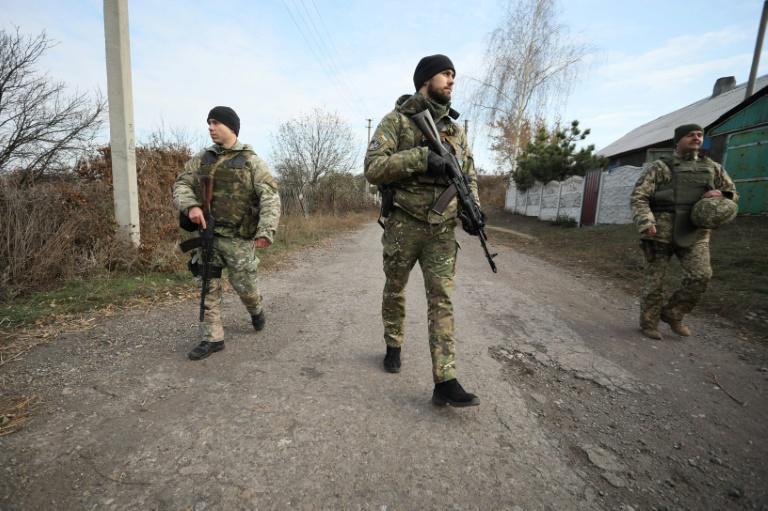 Ukrainian servicemen patrol in the streets of the village of Katerynivka, in the Lugansk region. The conflict in eastern Ukraine has been raging since 2014