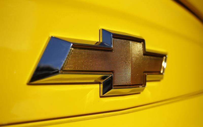 A Chevrolet logo is displayed on a vehicle at Courtesy Chevrolet dealership in Phoenix