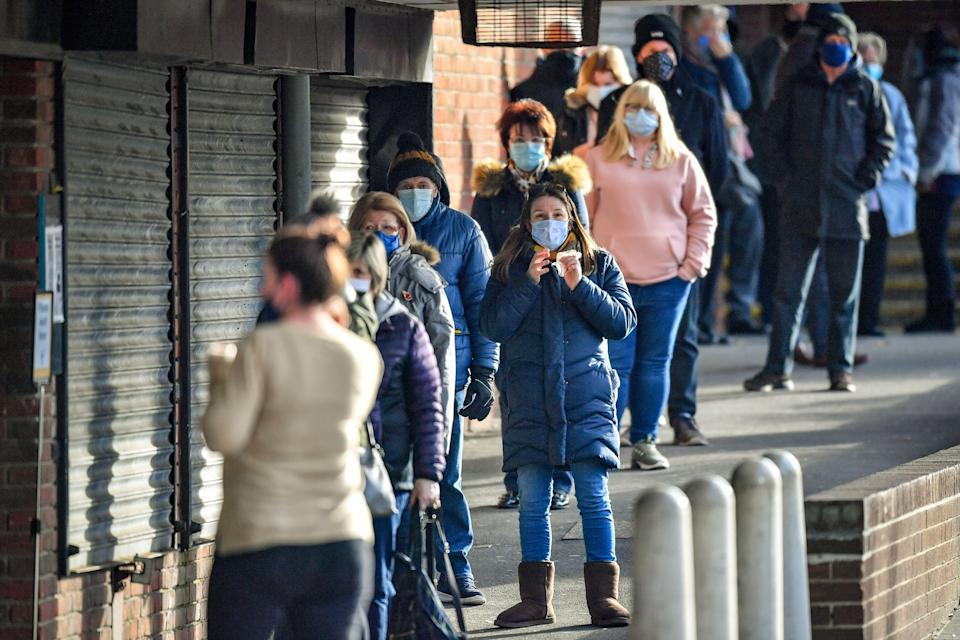 People wait in line for a coronavirus test at a surge test centre, set up in a library, to provide additional community testing following the identification of a mutated variant in the Bristol and south Gloucestershire area (Photo: Ben Birchall/PA Images)