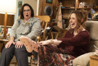 """This image released by Lionsgate shows Phyllis Smith, left, and Vanessa Bayer in """"Barb and Star Go to Vista Del Mar."""" (Richard Foreman/Lionsgate via AP)"""
