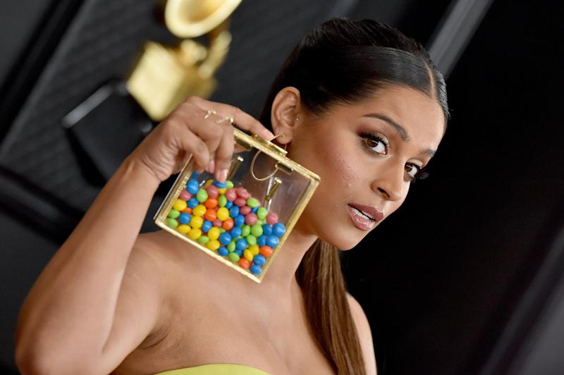 Lilly Singh's accessory was literally a clutch full of Skittles. (Photo: Axelle/Bauer-Griffin via Getty Images)