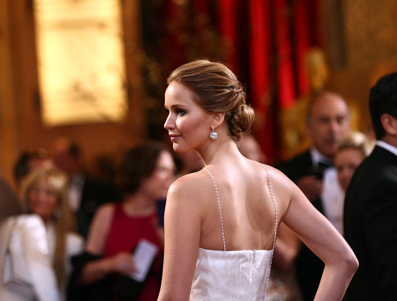 Actress Jennifer Lawrence arrives at the Oscars at the Dolby Theatre on Sunday Feb. 24, 2013, in Los Angeles. (Photo by Matt Sayles/Invision/AP)