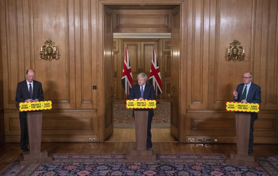 From left, Chief Medical Officer Chris Whitty, Prime Minister Boris Johnson and Chief scientific adviser Sir Patrick Vallance speaks during a media briefing on COVID-19, in Downing Street, London, Friday Jan. 15, 2021. (Dominic Lipinski/Pool via AP)