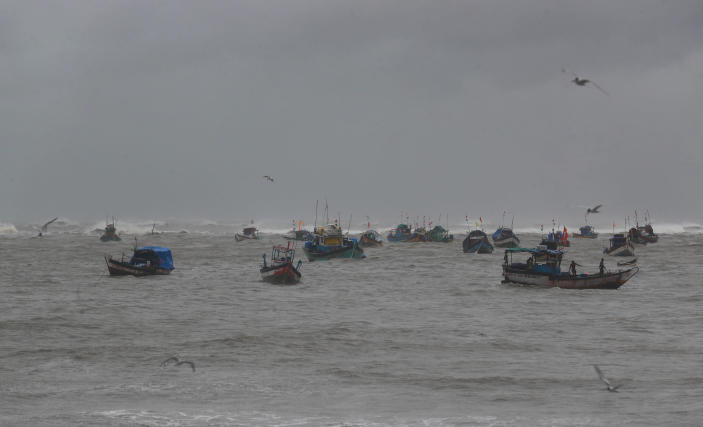 Fishermen try to return to the shores on the Arabian Sea coast in Mumbai, India, Monday, May 17, 2021. Cyclone Tauktae, roaring in the Arabian Sea was moving toward India's western coast on Monday as authorities tried to evacuate hundreds of thousands of people and suspended COVID-19 vaccinations in one state. (AP Photo/Rafiq Maqbool)