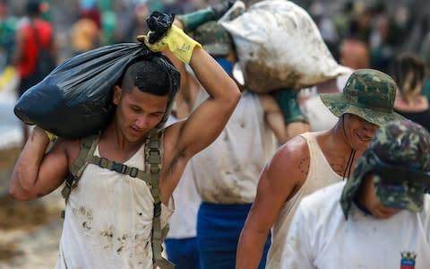 <span>It is the worst oil spill Brazil has ever encountered</span> <span>Credit: Diego Nigro /Reuters </span>
