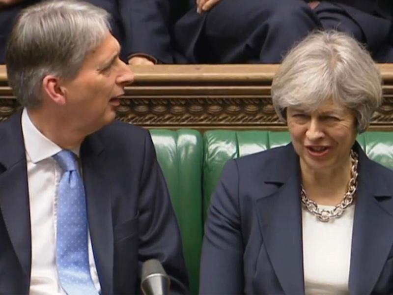 Chancellor Philip Hammond and Prime Minister Theresa May listen to Shadow Chancellor John McDonnell speaking in the House of Commons: PA