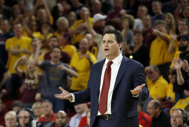 Arizona head coach Sean Miller looks at one of his players after a turnover during the second half of an NCAA college basketball game against Arizona State, Friday, Feb. 14, 2014, in Tempe, Ariz. Arizona State defeated Arizona 69-66 in double overtime. (AP Photo/Ross D. Franklin)
