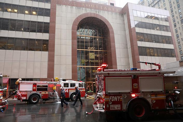 New York City Fire Department trucks are seen outside 787 7th Avenue in midtown Manhattan where a helicopter was reported to have crashed in New York City, New York, June 10, 2019. (Photo: Brendan McDermid/Reuters)