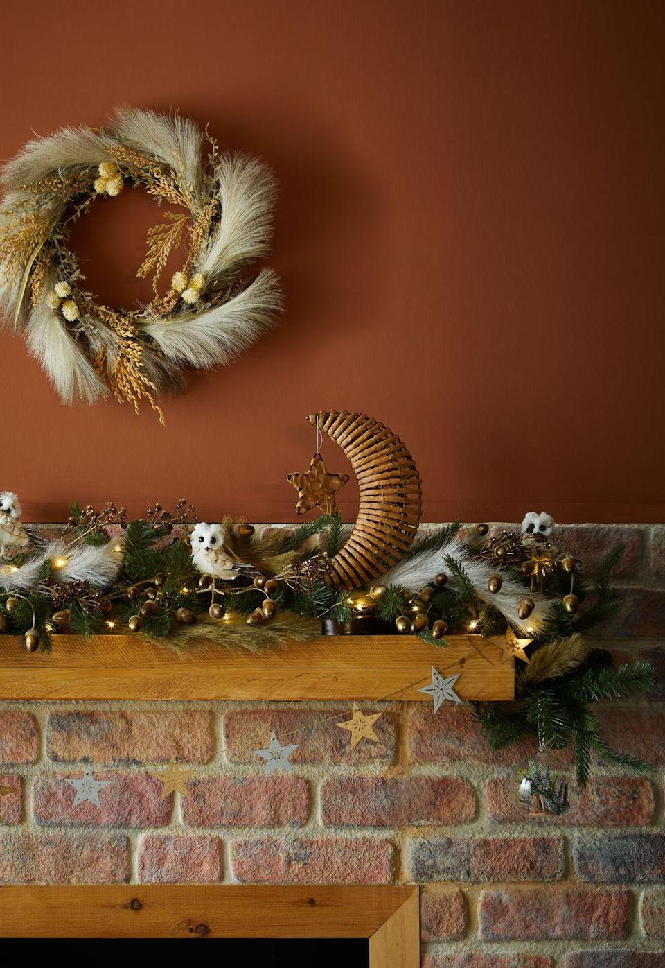 """<p>Give your fireplace an enchanting upgrade with gorgeous <a href=""""https://www.housebeautiful.com/uk/lifestyle/shopping/g29585316/christmas-garland/"""" rel=""""nofollow noopener"""" target=""""_blank"""" data-ylk=""""slk:garlands"""" class=""""link rapid-noclick-resp"""">garlands</a>, pampas wreaths and glistening lights. This year, discover Dunelm's plastic-free range, which includes natural and eco-friendly decorations for every corner of the home. </p>"""
