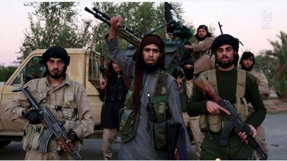 A man (C) identified in the subtitiles as Al Karar the Iraqi gestures as he speaks at an undisclosed location in this image taken from undated video footage released by Islamic State. Islamic State warned in the new video on November 16, 2015 that countries taking part in air strikes against Syria would suffer the same fate as France, and threatened to attack in Washington. Picture: REUTERS