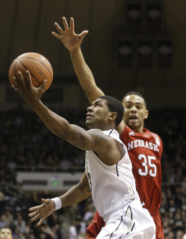 Purdue guard Ronnie Johnson, front, shoots in front of Nebraska forward Walter Pitchford in the second half of an NCAA college basketball game in West Lafayette, Ind., Sunday, Jan. 12, 2014. Purdue defeated Nebraska 70-64. (AP Photo/Michael Conroy)