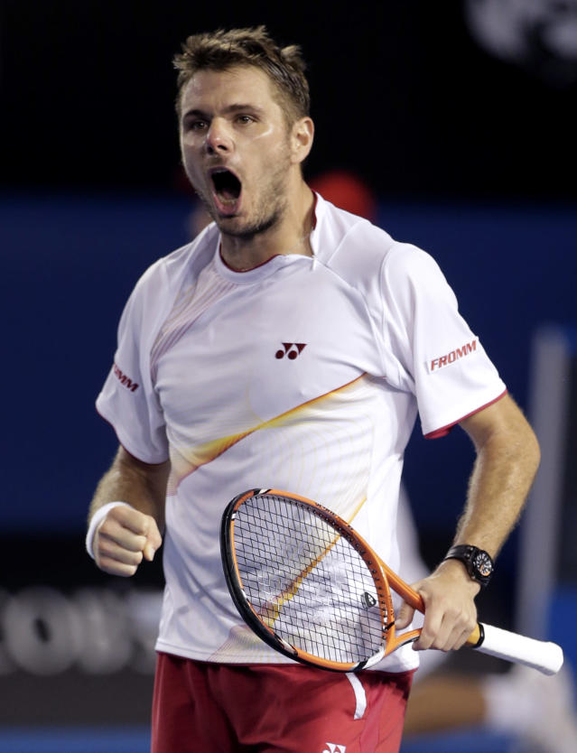 Stanislas Wawrinka of Switzerland celebrates after defeating Tomas Berdych of the Czech Republic during their semifinal at the Australian Open tennis championship in Melbourne, Australia, Thursday, Jan. 23, 2014.(AP Photo/Rick Rycroft)