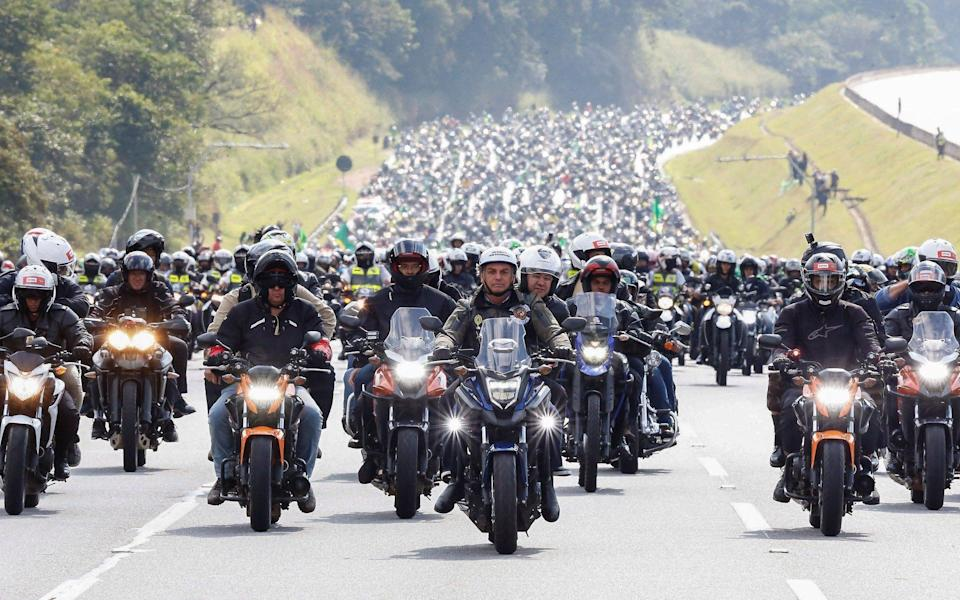 Jair Bolsonaro, front centre, during a motorcycle tour with his followers in Sao Paulo - Alan Santos/Presidency of Brazil/HANDOUT/EPA-EFE/Shutterstock