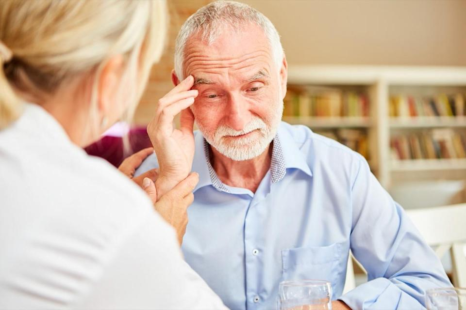 older man with dementia talking to doctor