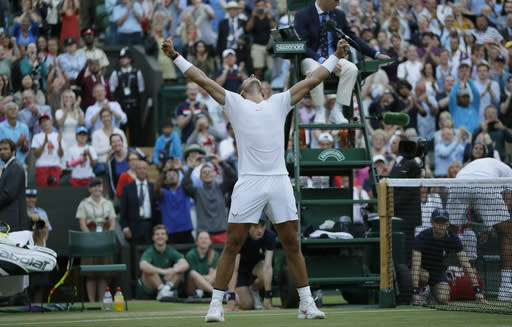 Rafael Nadal of Spain celerbates defeating Juan Martin Del Potro of Argentina in their men's quarterfinal match at the Wimbledon Tennis Championships in London, Wednesday July 11, 2018. (AP Photo/Kirsty Wigglesworth)