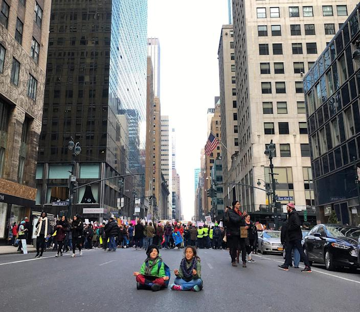 <p>Two children sit on Lexington Avenue and meditate on Lexington Avenue as thousands of people take part in the Women's March on January 21, 2017 in New York City. (Photo: Courtesy of Jessica Copi) </p>