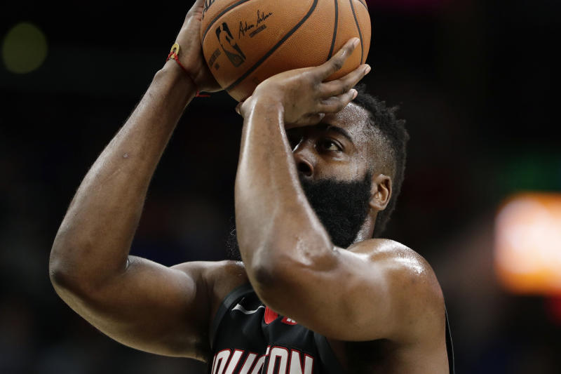 Houston Rockets guard James Harden shoots a free throw during the first half of the team's NBA basketball game against the San Antonio Spurs in San Antonio, Tuesday, Dec. 3, 2019. (AP Photo/Eric Gay)